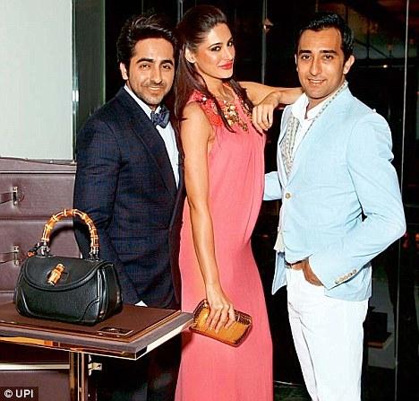 Actors Ayushmann Khurrana, Nargis Fakhri and Rahul Khanna at the store launch