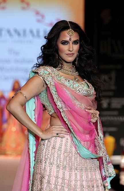 IIJW 2013 - Neha Dhupia walking the ramp for Day 2 show of Gitanjali