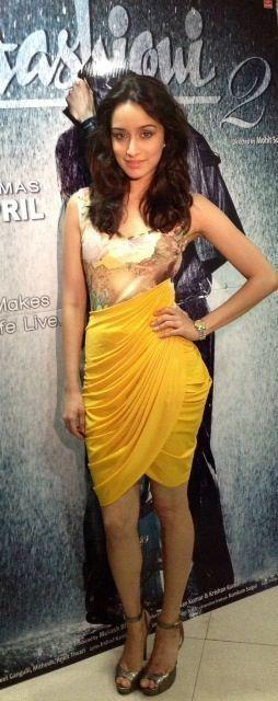 Shraddha Kapoor, in a yellow draped spandex tytler dress