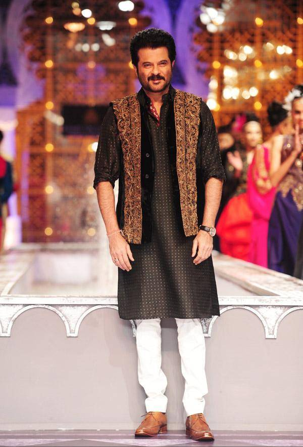 Anil-Kapoor displays a creation by designer Raghavendra Rathore on Day 3 of India Bridal Fashion Week