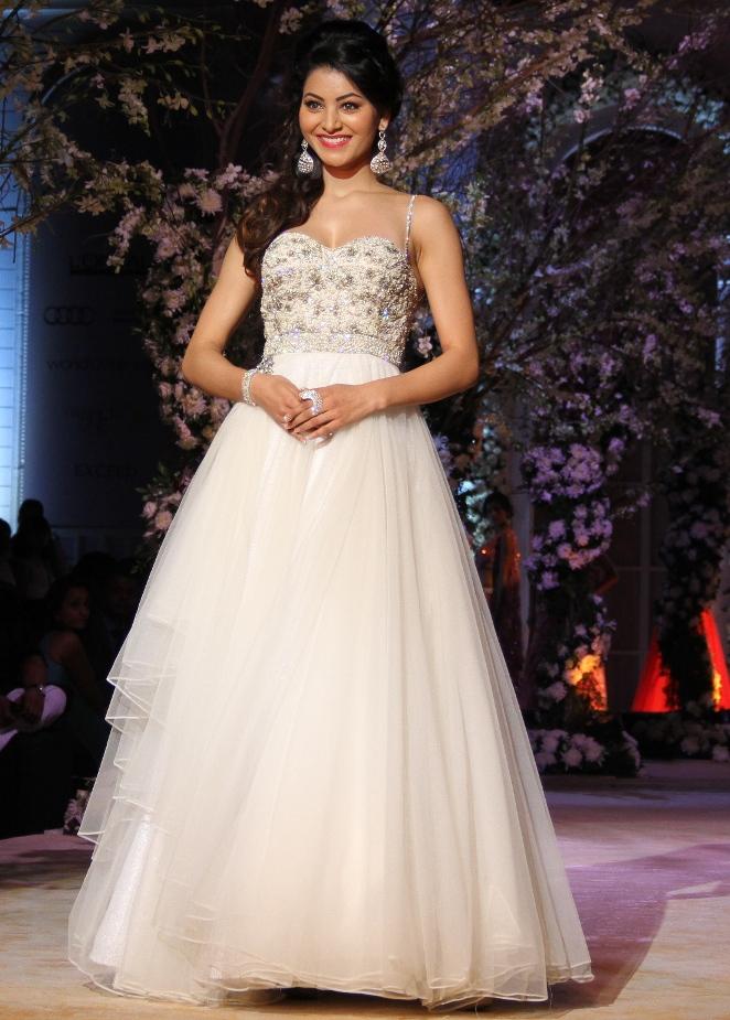 Actress Urvashi Rautela in a white tulle gown walking for Jyotsna Tiwari