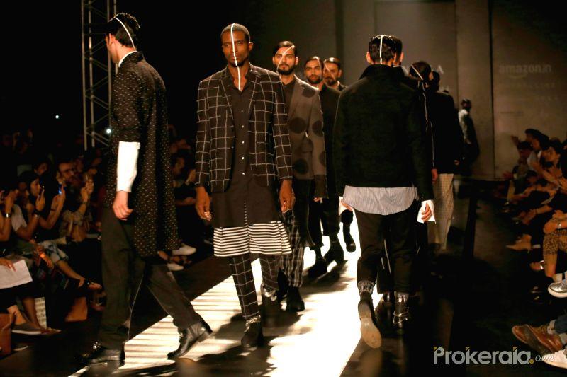 a-model-displays-the-creation-of-fashion-designer-465092